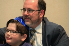 Rabbi David Fine and his son enjoying Betsy Teutsch's presentation about global tikkun olam