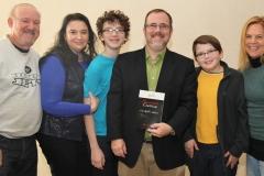 Rabbi David Fine (center) with family and Bernie and Beth Kotek