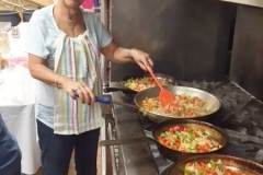Rena shows us how it's done, sauteeing veggies for shakshuka